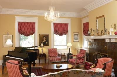 Draperies hung inside the window frame can help show off beautiful wood moulding.