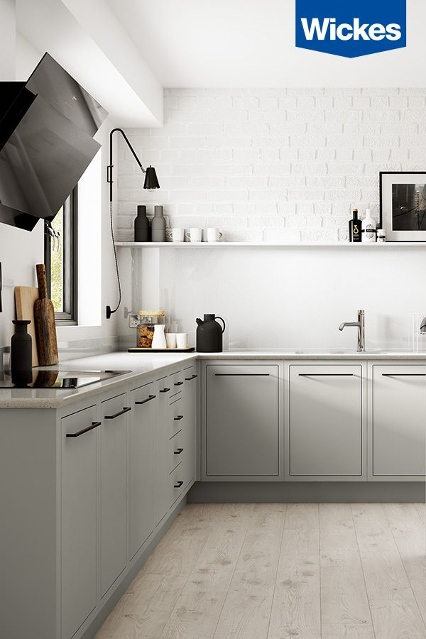 OUR FAVOURITE - NEW HANDLE COLOUR. Style the cool grey in-frame kitchen from Wickes with matt black and dark wooden accessories.