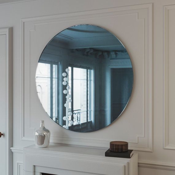 Blue midcentury mirror. Hanging blue wall mirror with light blue glass. 1950s inspired wall mirror with clear and pearlescent blue glass.