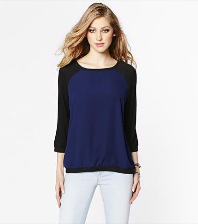 #DYNHOLIDAY Casual and glamorous! This color blocked bomber blouse looks fabulous paired with one of our jeans on a casual day.