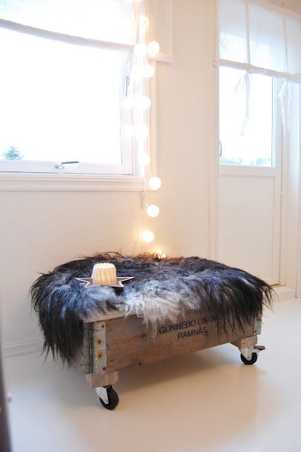 I would probably upholster rather than use the fur. Great idea for a cool ottoman.