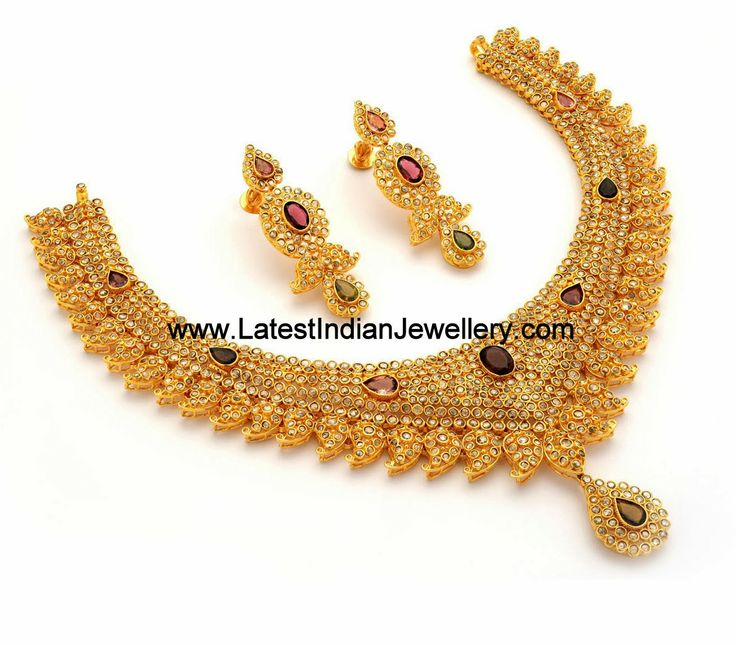 Designer 22 karat bridal necklace encrusted with uncut chakri diamonds in a stunning design with a line of paisleys at the bottom. Few colored gemstones add a contrasting touch to this admirable piece of jewelry.