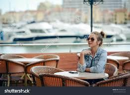 Image result for woman cafe seaside