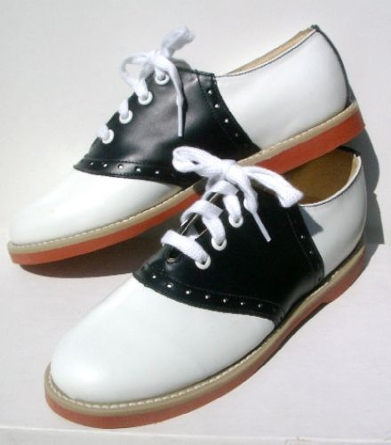 Saddle shoes ! These were popular in the 50's.  And it was still in style with grade and high schoolers in the 60's. Even in to the 70's.