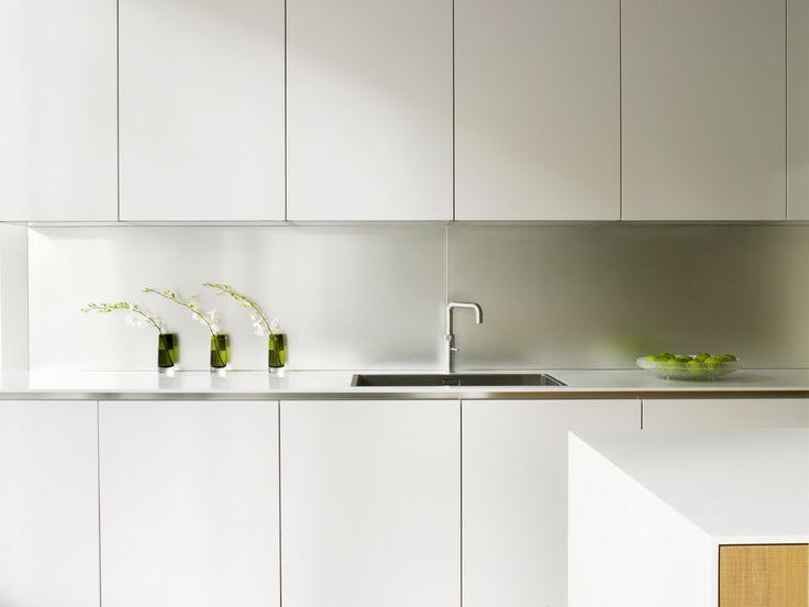 Systemat Range   Polar White Lacquer Matt Cabinetry   Designer White Corian    Stainless Steel