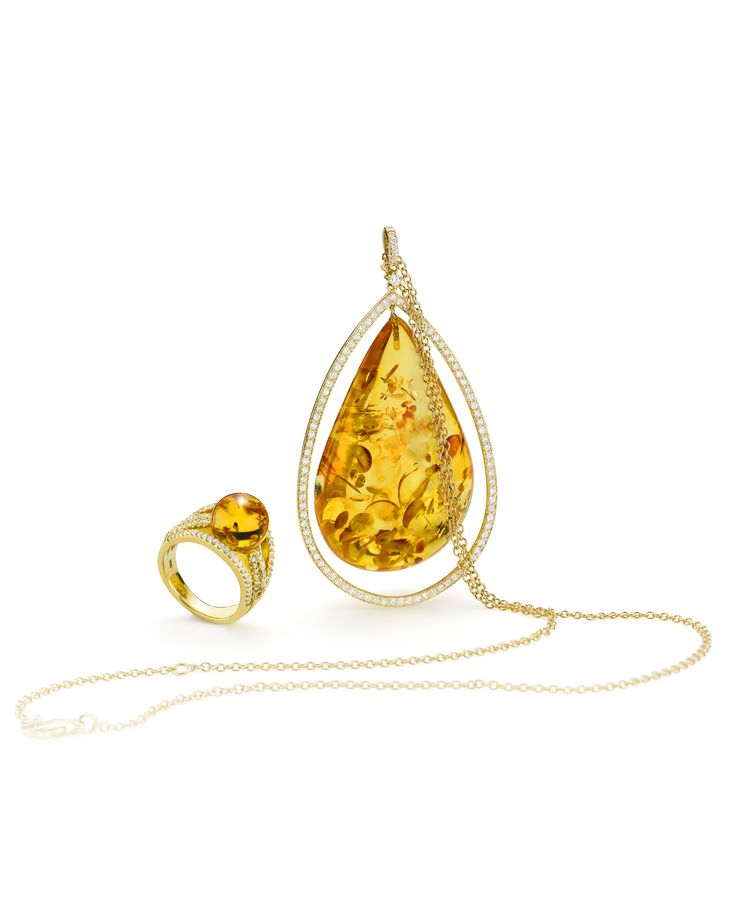 House of Amber - Gold pendant with diamonds from The Bond of Orbit Collection.