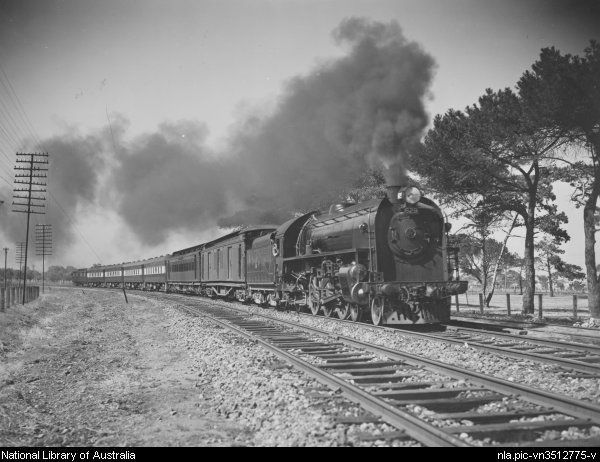 Buckland, John L 1915-1989. South Australian light Pacific 620 - class No. 629 wheels the westbound 'Perth Express' through the parklands towards North Adelaide en route to Port Pirie Junction where connection is made with the 'Trans-Australian Express', 1938 [picture]