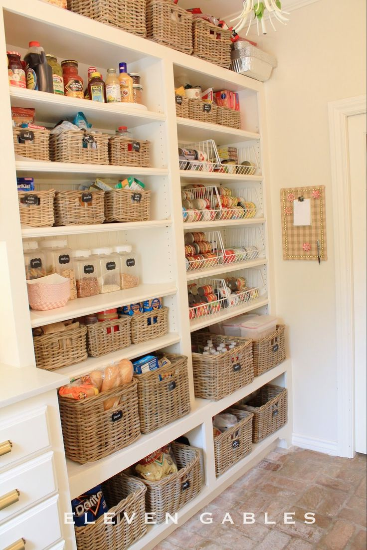 Wicker baskets create a unified and clean space—and are sturdy enough to keep bottles and packages standing upright.