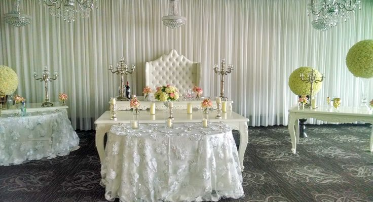 Open white table with pink mini roses and candles