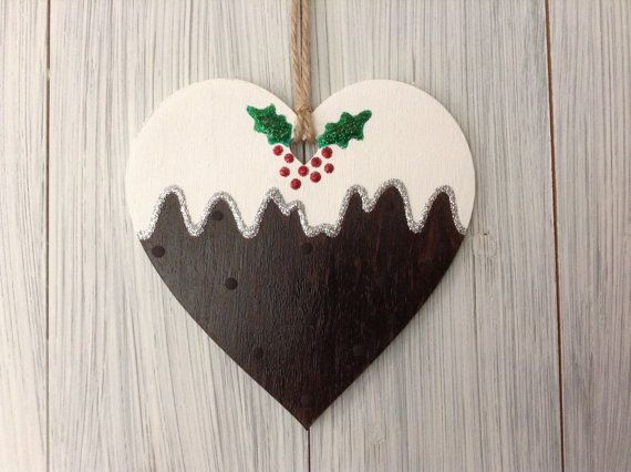 Christmas pudding wooden heart. Tree decoration. Seasonal ornament. Glitter holly and berries