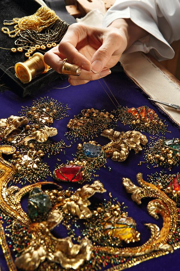 Broderies Vermont was founded in 1956 and modernized the industry with new techniques such as the chenille effects used by Chanel to edge her tweed suits. Below, a sample of their baroque-style embroidery with acanthus leaves embroidered in relief in gold thread and colored resin stones on clusters of old gold and bronze beads.