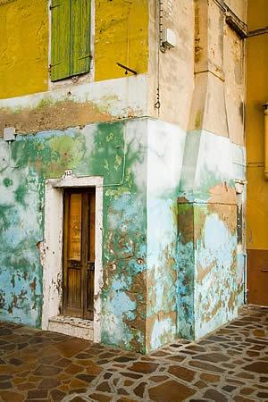 Burano, Italy peeling paint colors green acqua yellow