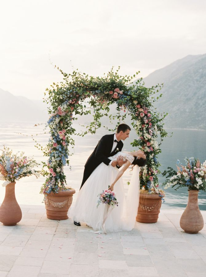 Friends, I've officially been bitten by the travel bug in a serious way. Because not only is this wedding stop-in-your-tracks pretty, but those Bay of Kotor views are straight from a postcard. To top it all off, this wedding photographer turned bride did