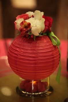you can use paper lanterns as flower vases and decorate your baby shower tables with it