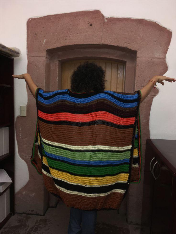 Poncho multicolor  en agujas