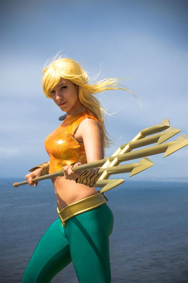 Technically, this is gender-swapped Aquaman from Earth 11, if you want to be really specific about it, and the girl with the trident is expert cosplayer Tenleid. Description from unrealitymag.com. I searched for this on bing.com/images