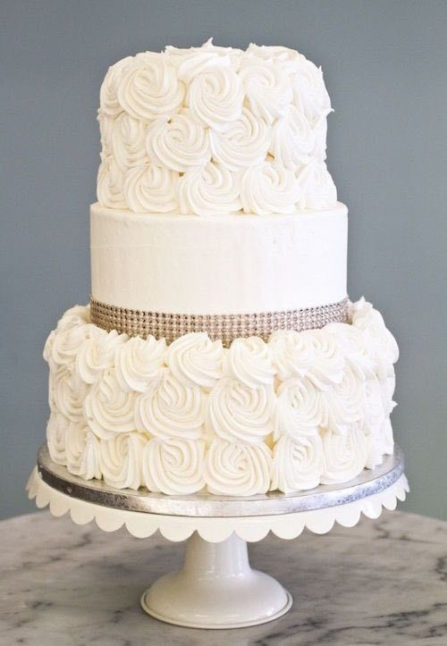 Classic and Elegant Wedding Cakes - MODwedding | Three Tier White Cake With A Crystal Ribbon Around The Middle Tier, & Top & Bottom Tier Decorated With Frosting Rosettes****