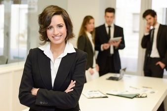 Smiling brunette manager with crossed arms