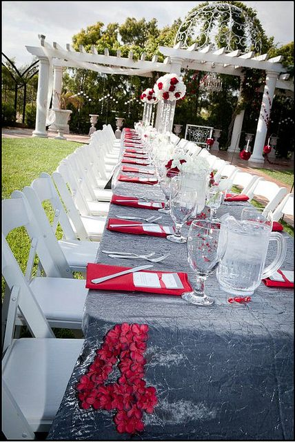 Wedding color theme in red. Family style dining in the Courtyard at Villa de Amore: Temecula Wine Country's Best Wedding Venue!  http://villadeamore.com