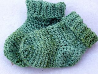These baby socks are simple to make and, though designed for handspun yarn, can be made with any sport weight or baby yarn.
