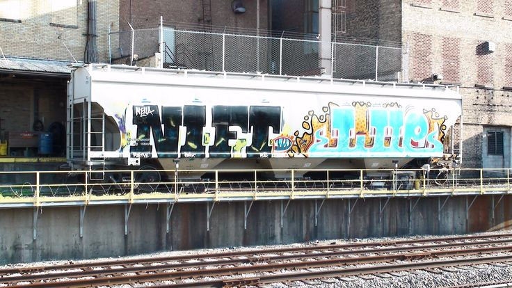 Here's some more vibrant graffiti art I found along Chicago's CTA Blue Line. The first two hopper cars were filmed at the Ferrara candy company by the Harlem...