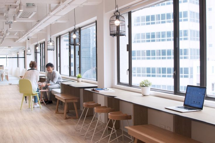 Uber Offices – Hong Kong. Breakout. Collaboration. Window ledge touchdown bench. Exposed ceiling painted white.