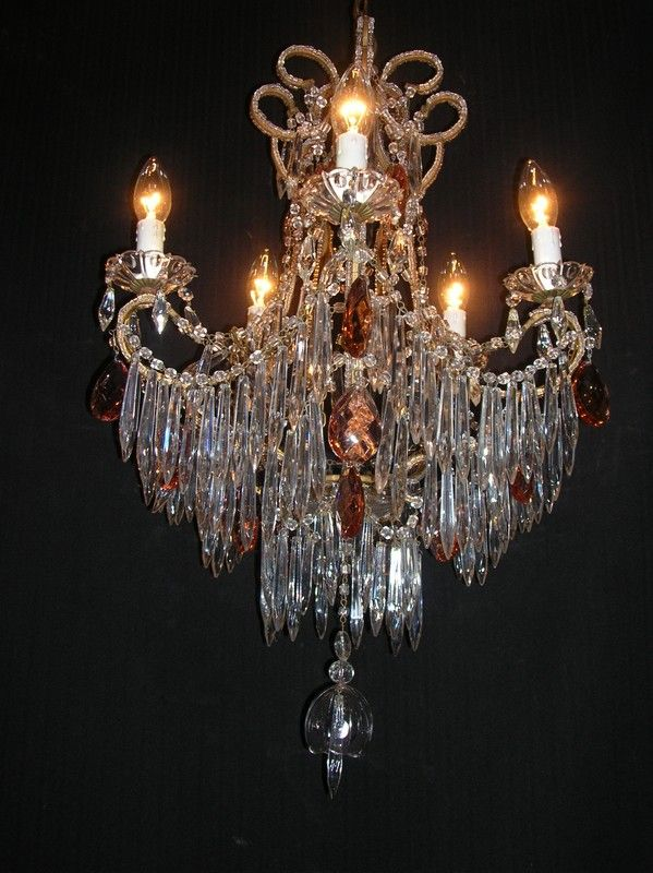 Antique French crystal chandelier with beaded arms and pale coloured raspberry drops. With a crystal bell to base.  Circa 1915