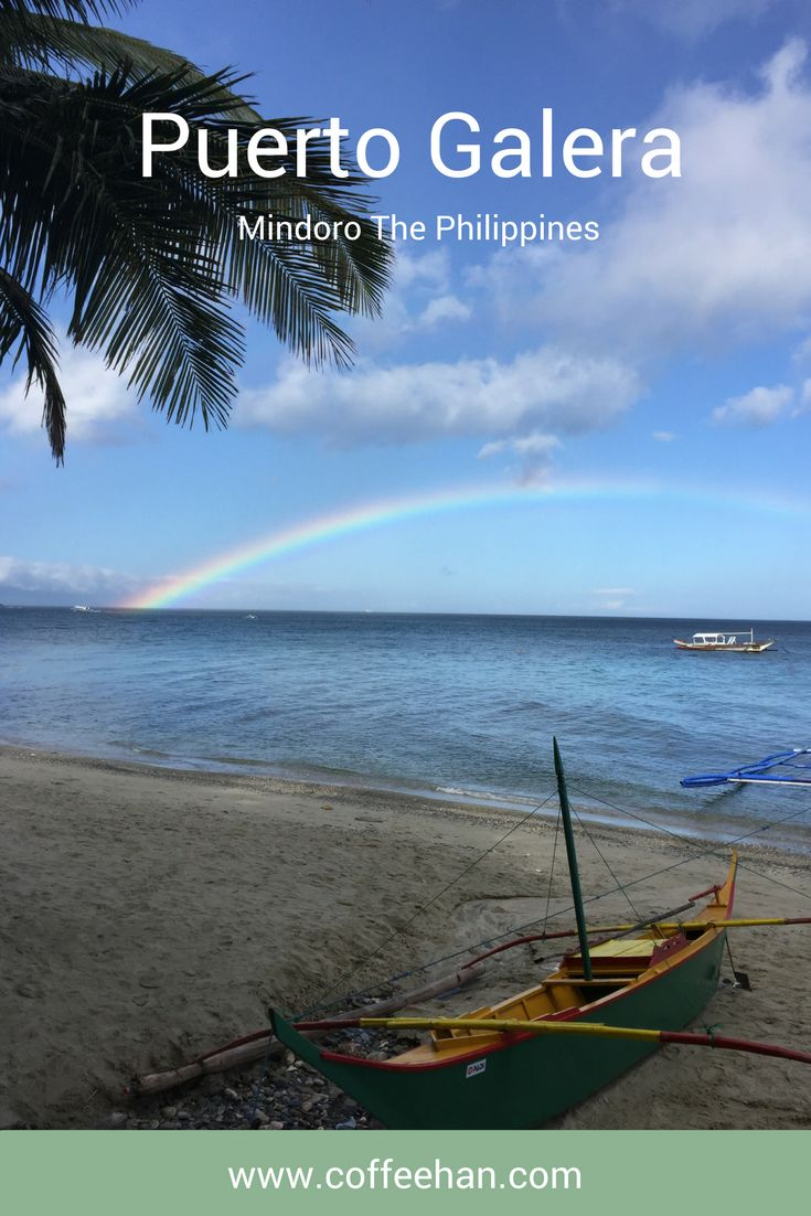 A rainbow appears on the horizon one afternoon as we were getting ready to go diving. This photo is taken in Puerto Galera.  Puerto Galera Mindoro, The Philippines