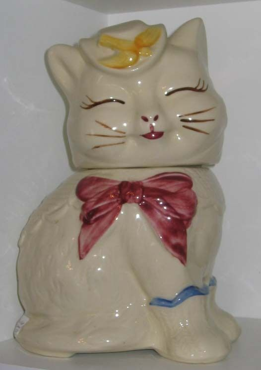"""Puss n' Boots"" [Shawnee Pottery Company - located in Zanesville, Ohio. The Shawnee Pottery Company began operation in 1937, taking its name in part from a nearby village of Native Americans and the distinctive red clay from which they made pottery.]~[Shawnee Pottery Company]"