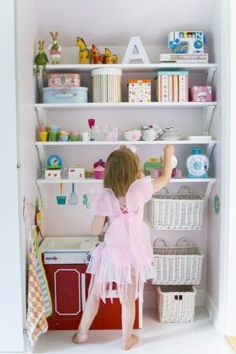 Maybe shelving like this for alcove in each kids' room with comfy seating for reading and light instead of play kitchen at bottom.  Over-sized beanbag chair or two beanbag chairs to accommodate two kids?