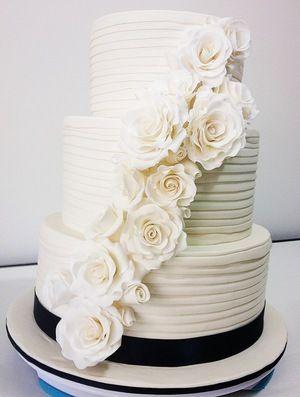 Elegant cascading roses wedding cake