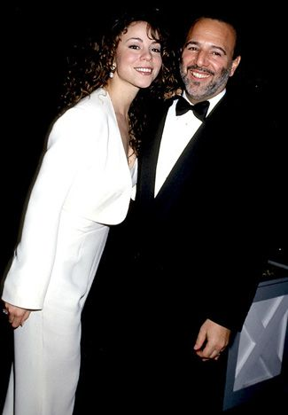 Mariah Carey and Tommy Mottola Carey wed the Columbia Music executive -- who helped her make her first album -- in 1993, when she was 23. They separated in 1997, and divorced the following year.   Read more: http://www.usmagazine.com/celebrity-news/pictures/stars-who-wed-too-young-200919/2859#ixzz2khfk0GUP  Follow us: @Us Weekly on Twitter | usweekly on Facebook