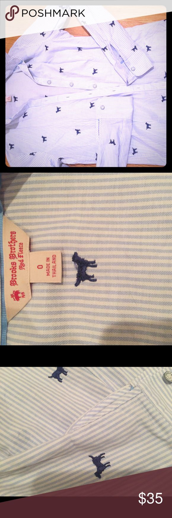Brooks Brothers women's pinstripe Preppy Oxford Blue and white pinstripe button down. Very high quality! Little dogs etched in blue all throughout shirt. Looks great paired with a puffer vest or sweater for fall and winter seasons. This is from Brooks Red Fleece line geared towards young adults. This was purchased by me in a Brooks retail store. No longer fits me across the chest. Size is 0. Brooks Brothers Tops Button Down Shirts