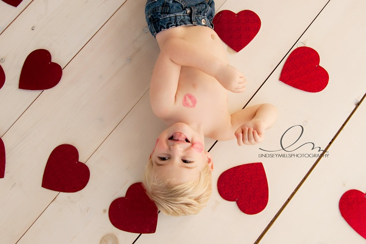 Photo, children: little boy with kiss on cheek surrounded by hearts