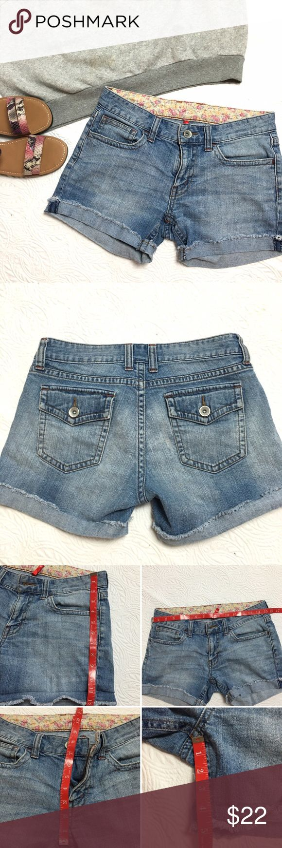 Uniqlo Distressed Denim Shorts sz 28 Uniqlo Distressed Denim Cuffed Shorts with Floral Waist Band and a touch of stretch.  There is a few  faint yellow stains on back (shown) not very noticeable otherwise nice clean condition. 👍OFFERS welcome. 🚫no trades pls Uniqlo Shorts Jean Shorts