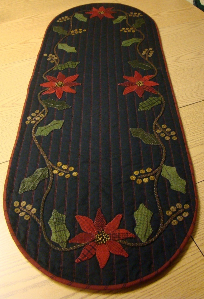 Poinsettia Runner - FINALLY found the pattern here: http://homesteadstitches.com/?wpsc-product=holly-poinsettia-table-runner-kit-duplicate