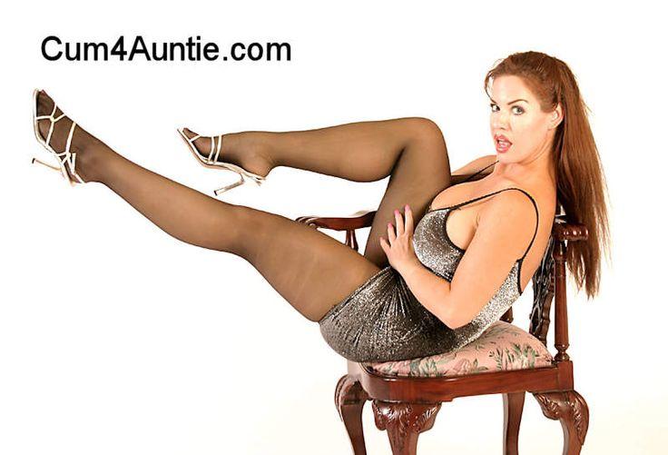 Barbra Hart in a mini skirt and nylon stockings and high heels