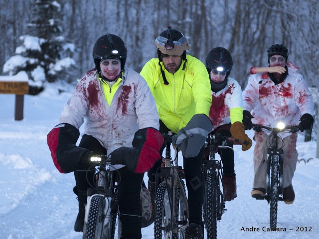 """""""Proving that winter isn't the end of the world for bicycling, Anchorage residents got a preview of the apocalypse thanks to a parade of cycling zombies this past weekend. The inaugural Zombie Apocalypse Winter Bike Ride drew more than 60 costumed cyclists for a five-mile ride on road, trails, and even across a frozen lagoon."""" -MP via Rachel Poretsky"""
