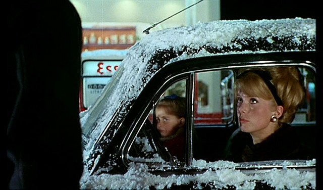 The Umbrellas of Cherbourg.  The end of the movie where she runs into the love of her past.