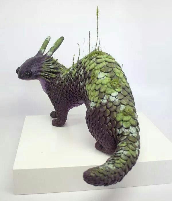 """.'The Dobhar-chú is a creature of Irish folklore and a cryptid. Dobhar-chú is roughly translated into """"water hound."""" It resembles both a dog and an otter though sometimes is described as a half dog, half fish. It lives in water and has fur with protective properties.'"""