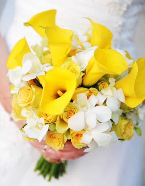 Loose posey; Yellow cala lilies, white Thai orchids with yellow and white roses. Weddings in Thailand.