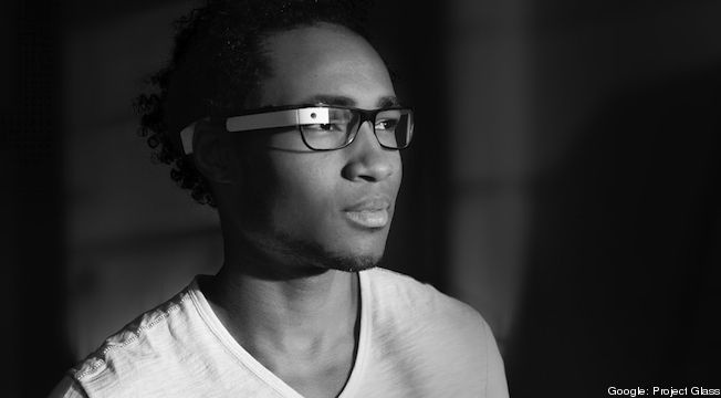 A photo of a model wearing a prescription version of Google Project Glass computerized glasses. -- Not sure I like the design of the glasses but the idea is great...