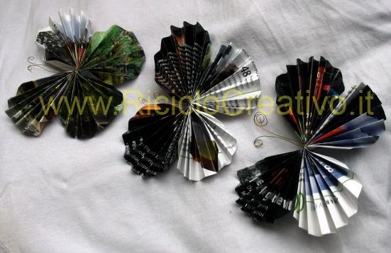 Farfalle realizzate con la carta patinata delle riviste: