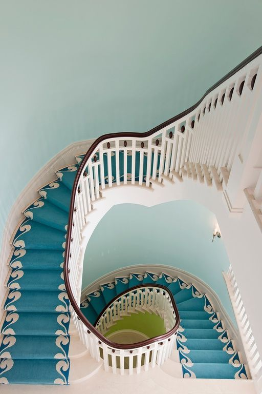Edwardian Hall (Sammie Designs) - Stair runner in cerulean blue with an eggshell wave pattern on the edges.  The striking architecture combined with the use of bold color and pattern, make this staircase absolutely spectacular.