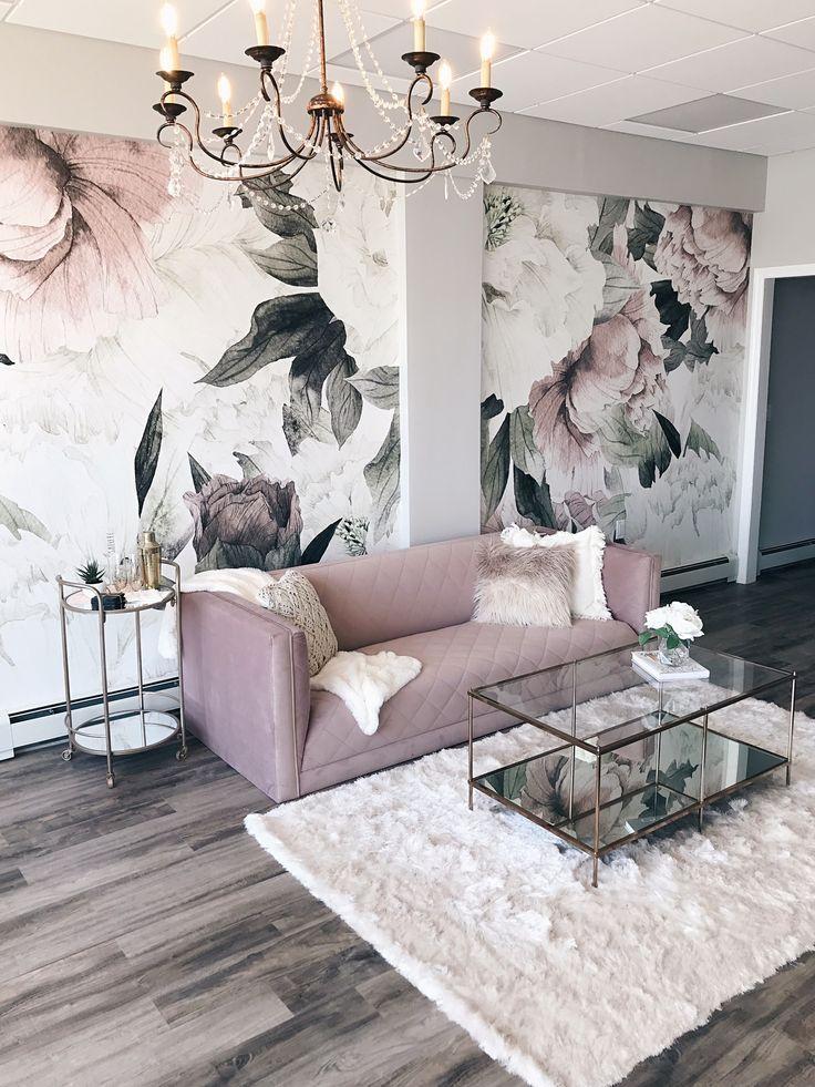 modern glam interior design featuring blush pink velvet sofa, glam chandelier an