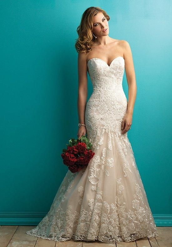 Uniquely embroidered lace applique is the focal point of this fit and flare strapless gown.