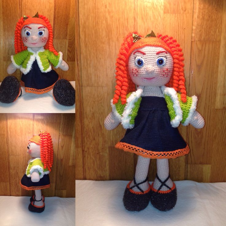 Crochet Carol doll, 35 cms tall, with denim dress and crochet coat. In the doll's hair there are two ribbon.