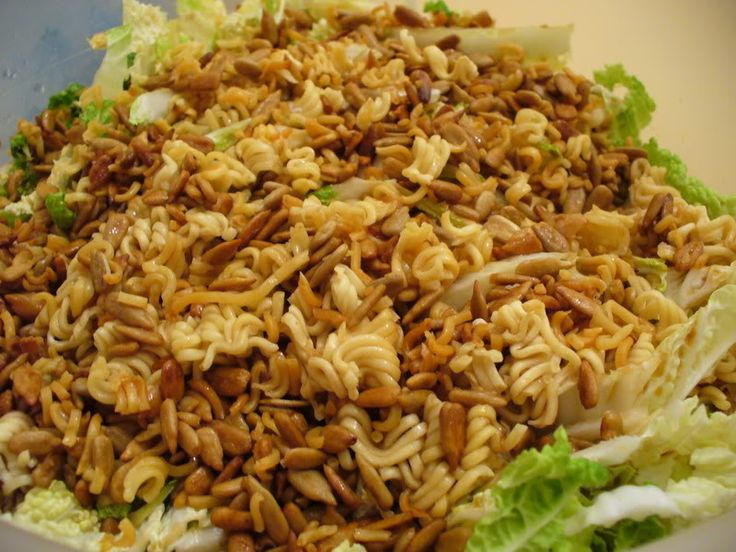 The Good Wife: Napa Cabbage Salad (I do not use the sesame seeds instead i use sunflower seeds and almonds. Also I use Splenda in place of the white sugar. )
