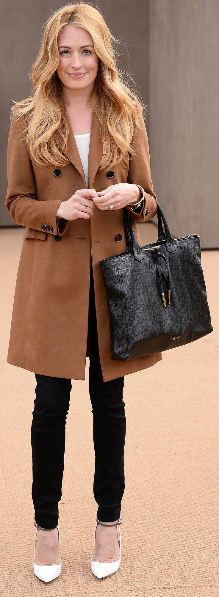 British presenter Cat Deeley wearing Burberry at the Burberry Prorsum Womenswear Autumn/Winter 2014 Show in London