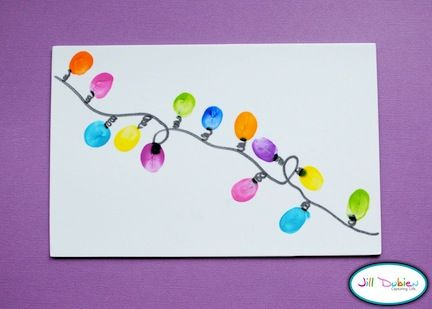 """Thumbprints used to make glorious little light strand....  Have seen this around a picture frame for a class Christmas gift for a teacher or volunteer. """"You light up our lives"""""""